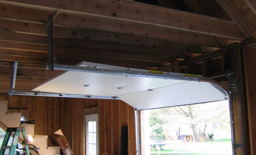 i finished building the second garage door before christmas worked on the high lift track today the high track is bolted to the vertical track and is also